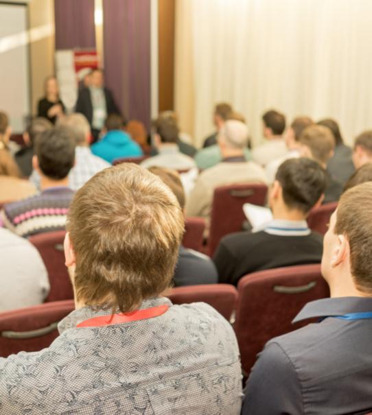 audience watching conference speaker on elder abuse